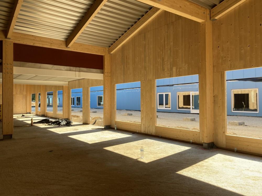Abscis Architecten - CLT sporthal tijdens werffase, van binnenuit