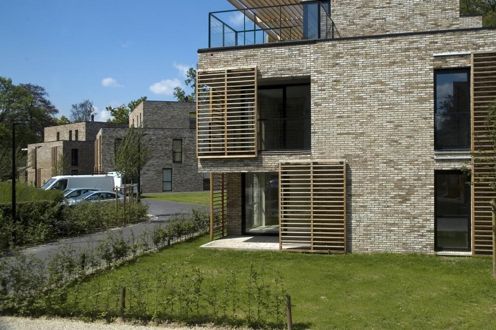Abscis Architecten - Drie woonvolumes geïntegreerd in het groene Kasteelpark Viteux –  fotografie Abscis Architecten